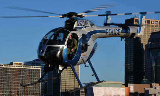 With downtown Louisville behind it, the MD 520N climbs out after a landing on an Ohio River island.