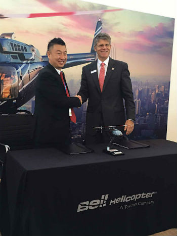 Zheng Gang (left), chairman of Reignwood Aviation with John Garrison, president and CEO of Bell. Bell Helicopter Photo