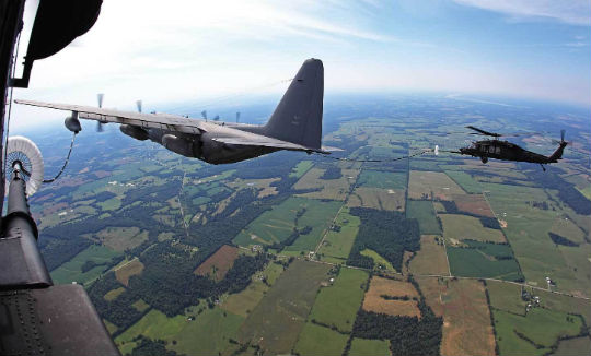A SOATB Sikorsky MH-60M Black Hawk crew performs aerial refueling from a U.S. Air Force MC-130P Combat Shadow special operations tanker. The MH-60Ms may also be found air-to-air refueling from U.S. Marine Corps KC-130Js.