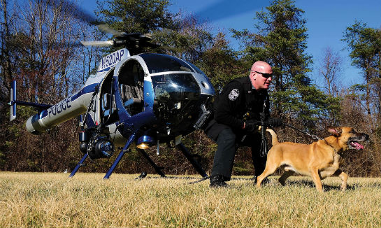 The ASU works with multiple units within the police department. Here, the aircraft deploys a K-9 team during an insertion training event.