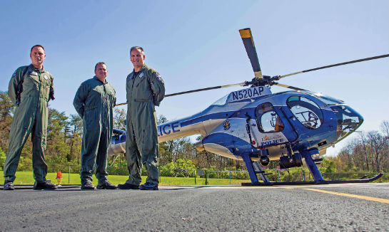 From left, the ASU's Pilot/Officer Chris Colburn, Lt. Brent Routzahn, and Pilot/Officer Bryan Arnold pose with the unit's MD 520N. Wales Hunter Photo