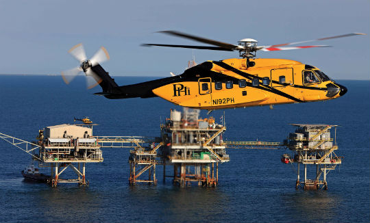 A PHI Sikorsky S-92 flies offshore in the Gulf of Mexico. About two-thirds of the company's revenue derives from offshore transport to rigs in the Gulf; most of the rest comes from its EMS operations. Ted Carlson Photo