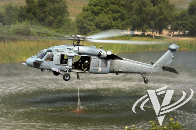 An MH-60S picks up another load of water during a demonstration earlier this year at a lake in Camp Pendleton.