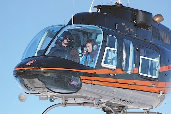 Megan Tyler, left, flies passenger Hannah Allan as part of The Skys No Limit  Girls Fly Too! event in Yellowknife, N.W.T. Allan was one of 422 girls who went for helicopter rides during the event. Ralph Christofferson Photo