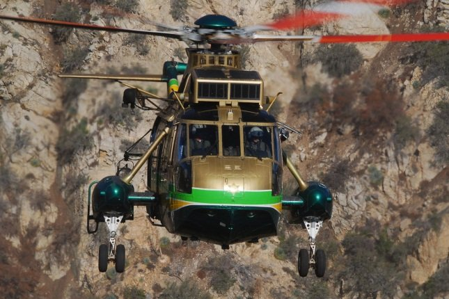 Los Angeles County Sheriff's Department (LASD) SH-3H Air Rescue 5 performs a hoist rescue in the Angeles National Forest.