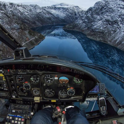 Climbing out over the lake by Trolltunga