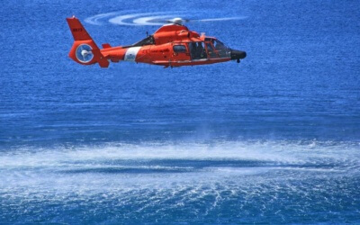 A Coast Guard H-65 Dolphin in a hover.
