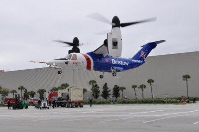 An AgustaWestland AW609 departs the Orange County Convention Center following Heli-Expo 2015.