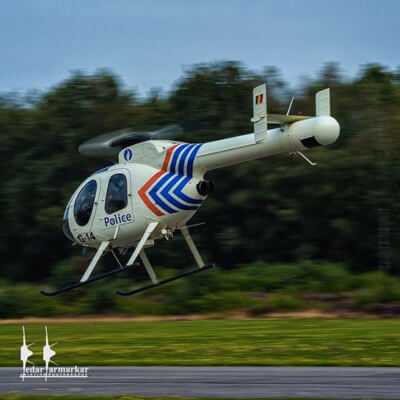 1/30 shot of a Belgium Police MD 520N on takeoff — giving the unusual effect of a very small main rotor!