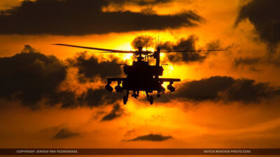RNLAF Apache flying towards the sun.