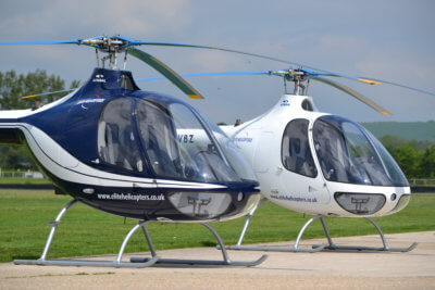 Two helicopters resting on the ground