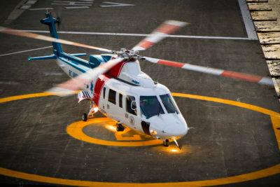 Helijet helicopter on landing pad.