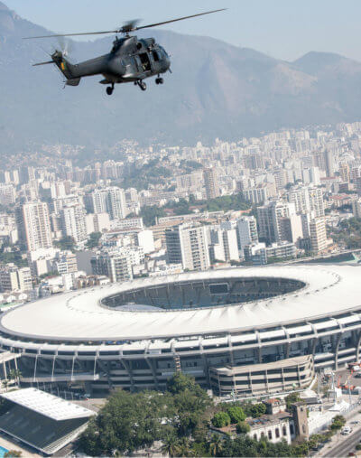 Helicopter flying with stadium in background.