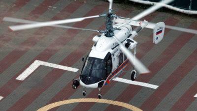 Ka-226T helicopter flying over helipad.