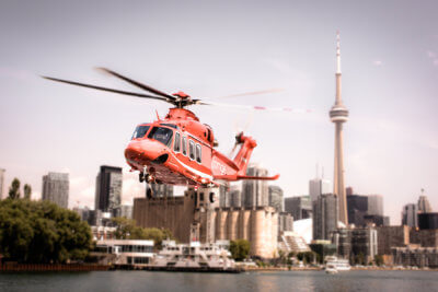 An AW139 flies above the city of Toronto.