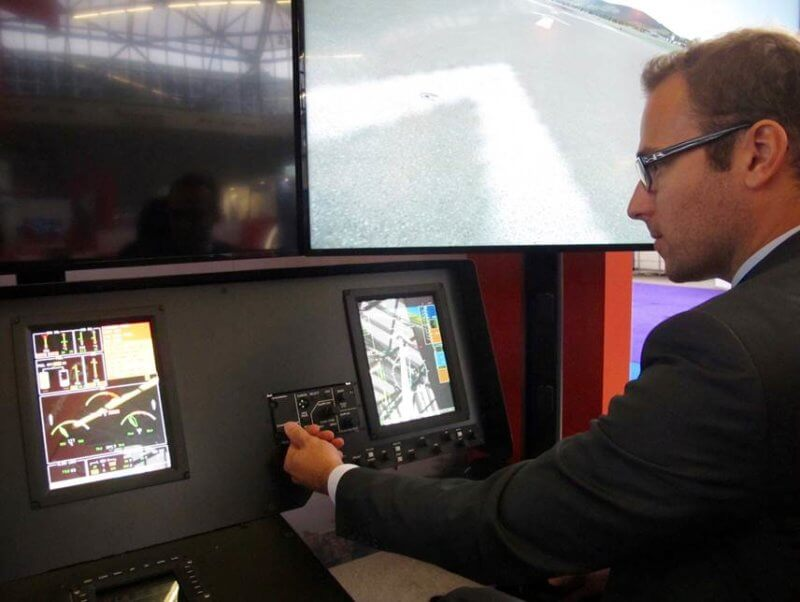 Man in front of screen