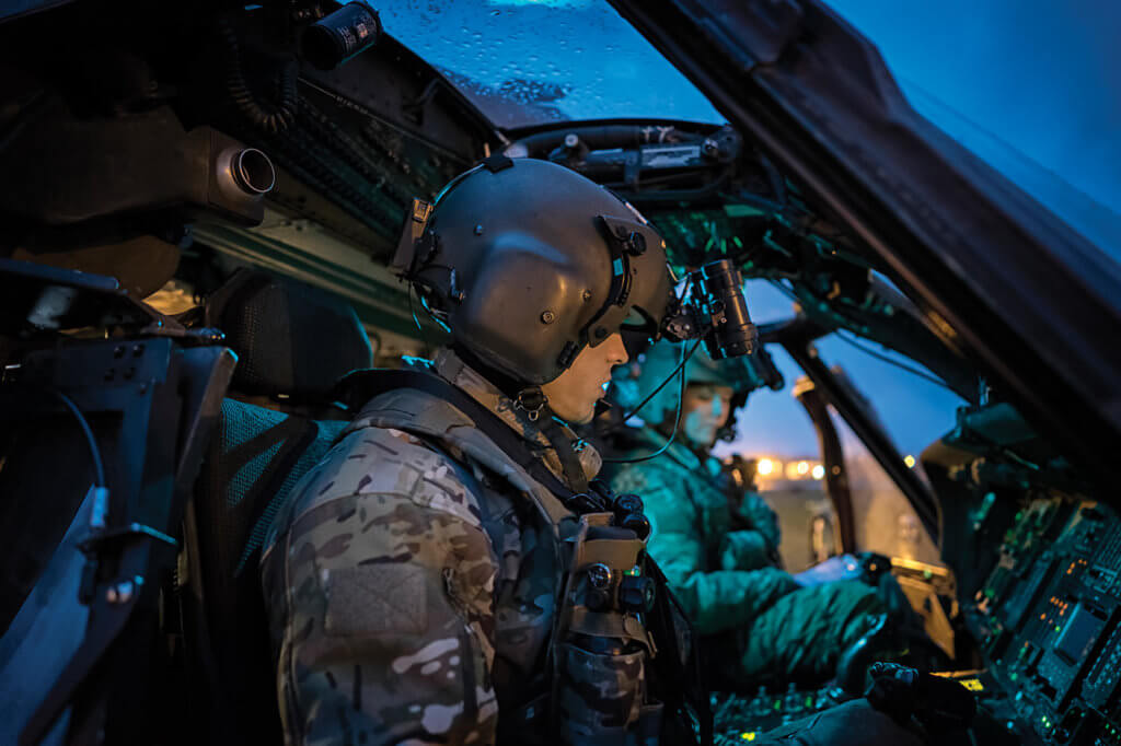 56th Rescue Squadron pilots go through their pre-flight checklist prior to a night sortie at their home base, RAF Lakenheath.