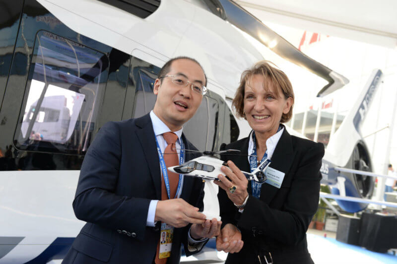 CMIG leasing and Airbus Helicopters representatives hold a model of the H160.