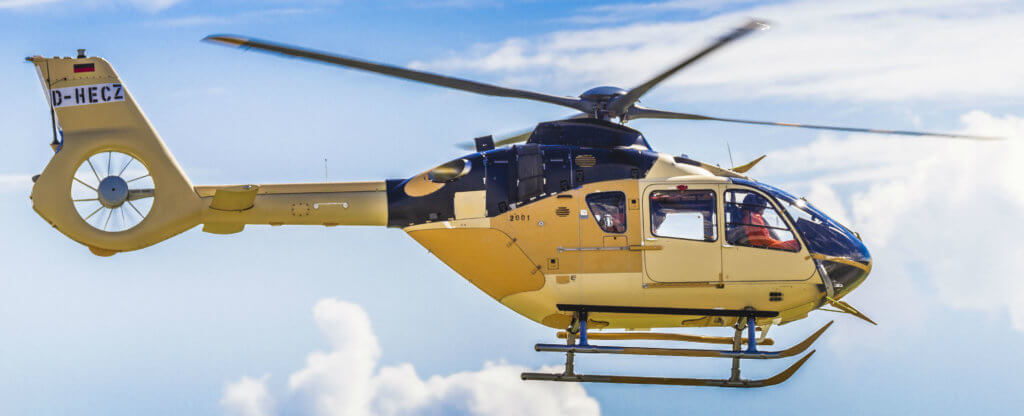 Airbus H135 helicopter in flight.