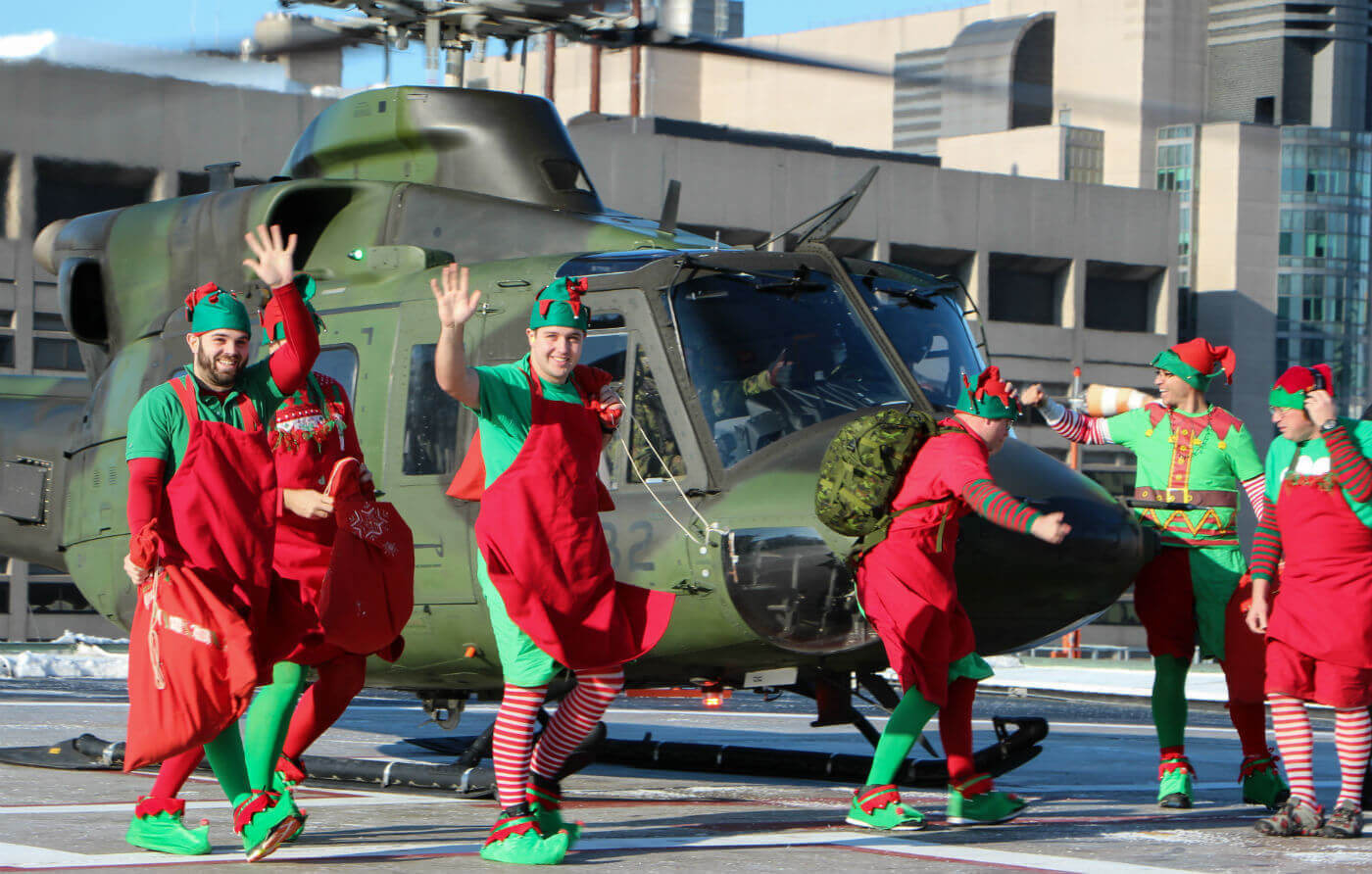 It's go time! The elves arrive on the rooftop helipad at SickKids hospital. Steve Bigg Photo