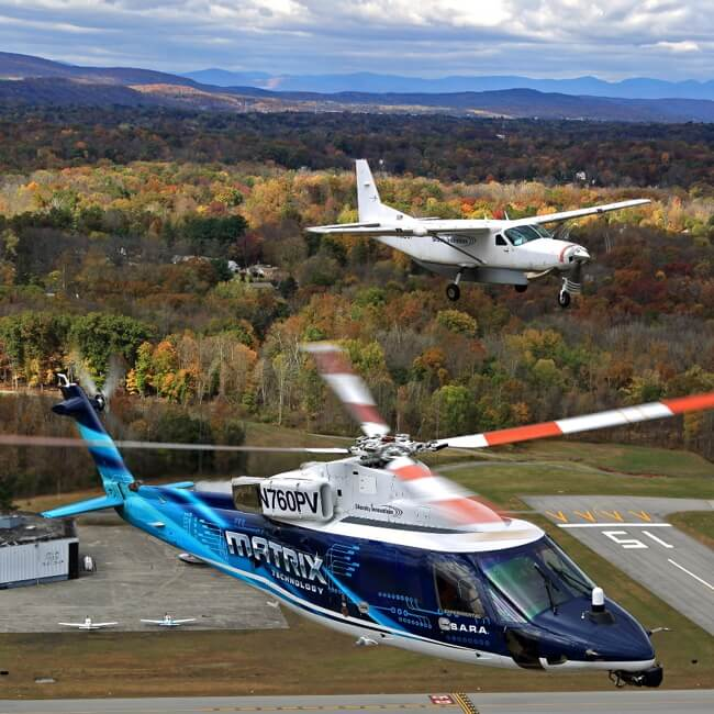 DARPA's Aircrew Labor In-Cockpit Automation System (ALIAS) program demonstrates its developmental technology system on a Cessna 208 Caravan fixed-wing aircraft and a Sikorsky S-76 helicopter during Phase 2 flight tests. DARPA Photo