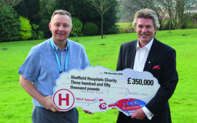 David Reynolds, director of Sheffield Hospitals Charity, receives the cheque from Robert Bertram, CEO, HELP Appeal. HELP Appeal Photo