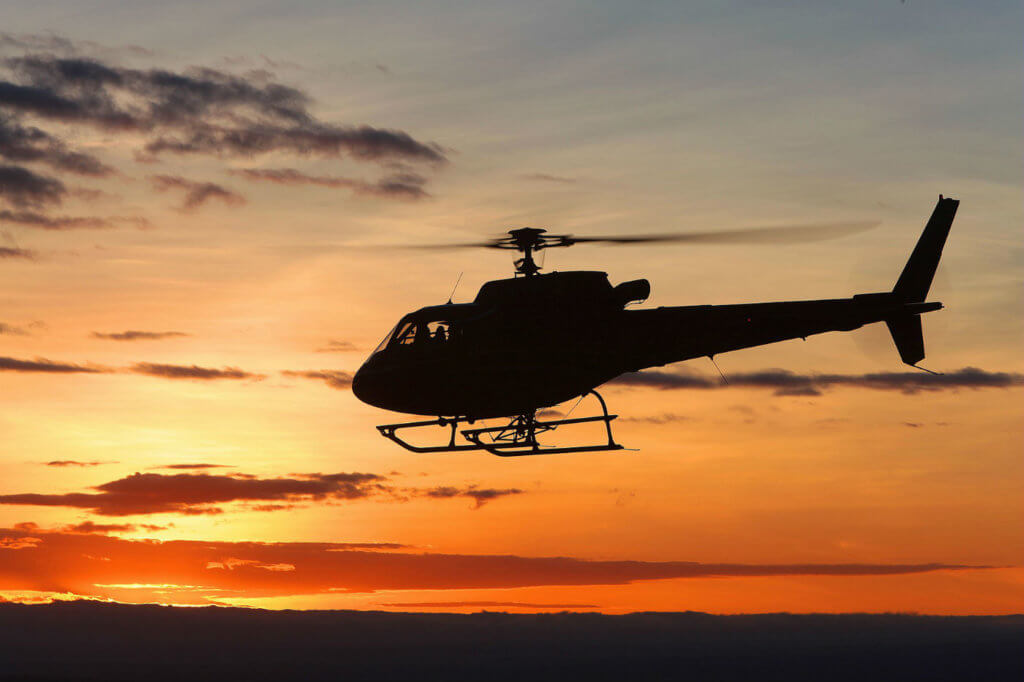 An H125 in silhouette