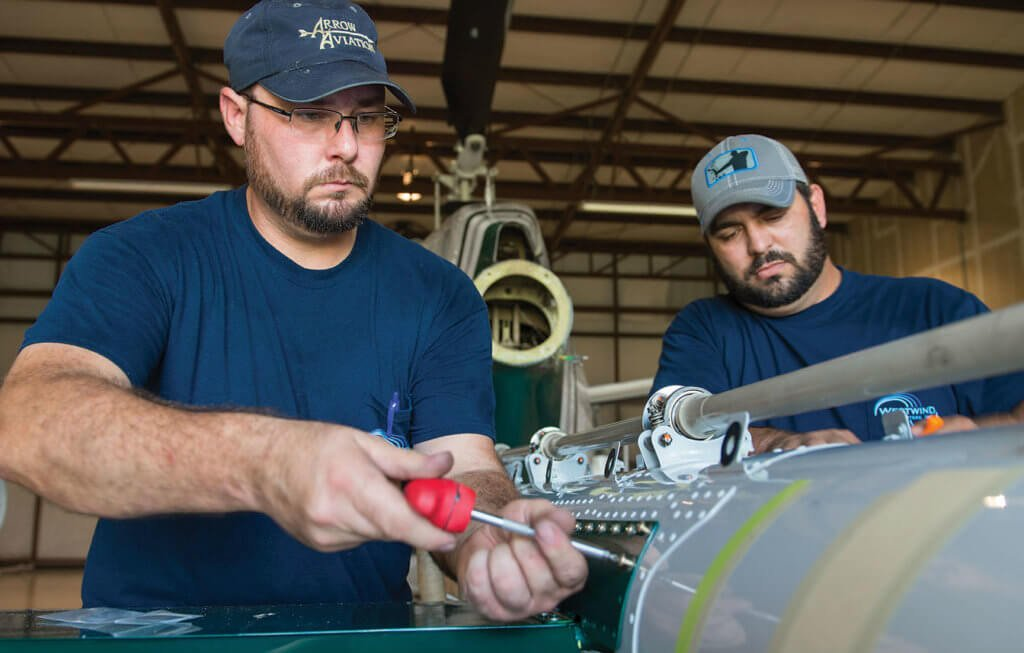 Aircraft maintenance technicians Jeremy Copper and Nathan Fowler are based at the Abbeville base, which handles the majority of the company's maintenance.