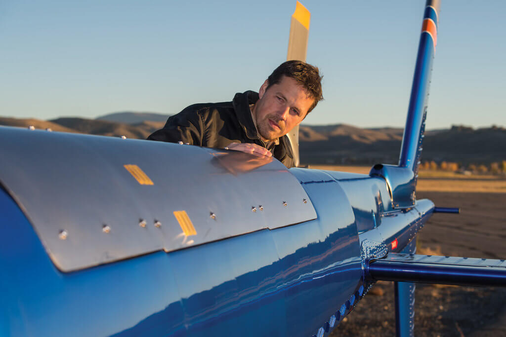 BLR director of helicopter programs and experimental test pilot Dan Smith examines the tailboom prior to flight.