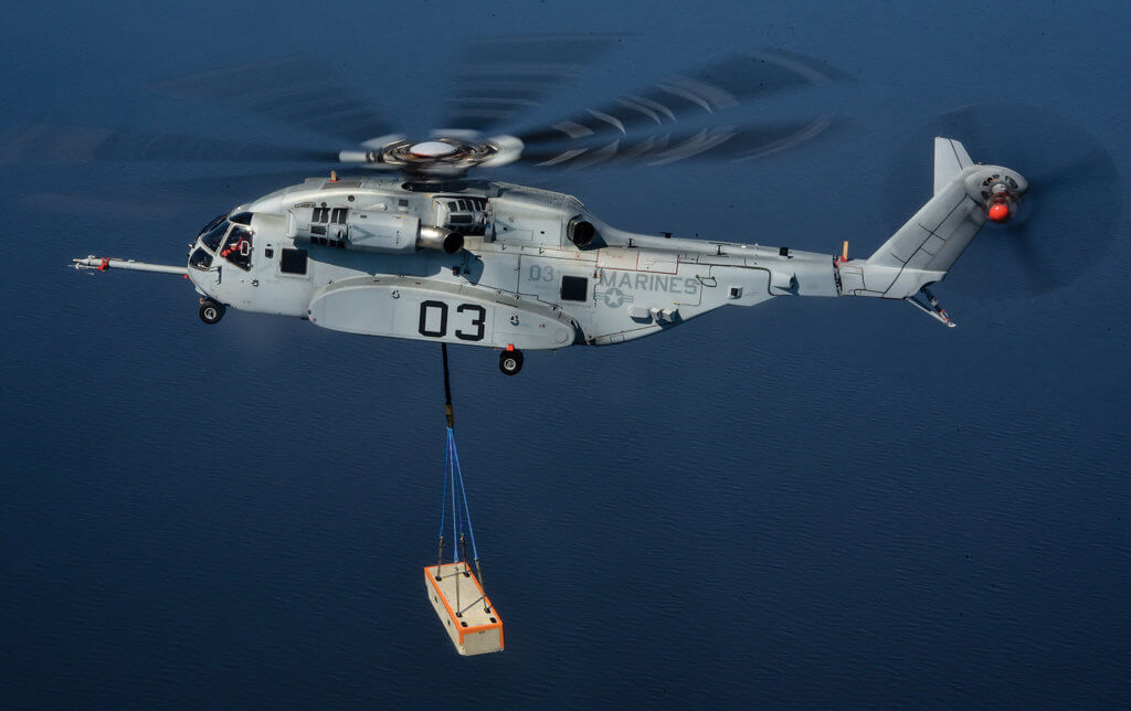 The CH-53K's center hook is rated for 36,000 lbs. (16,329 kg), while the fore and aft hooks are rated for 25,200 lbs. (11,400 kg).