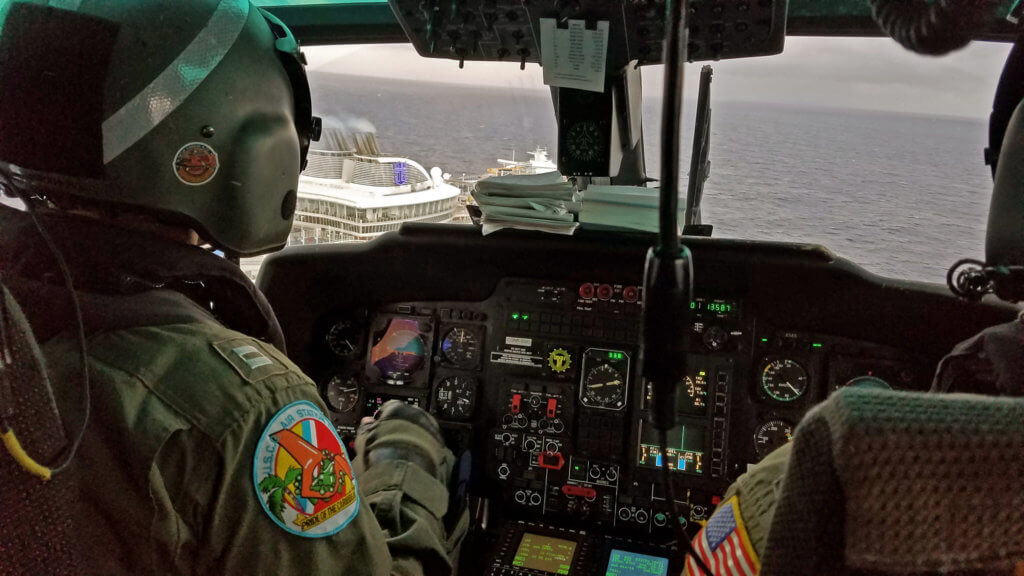 The crew of an MH-65D Dolphin from Air Station Borinquen in Aguadilla, Puerto Rico, conducted a medical evacuation from Harmony of the Seas on Jan. 1. Photos courtesy of Matt Udkow