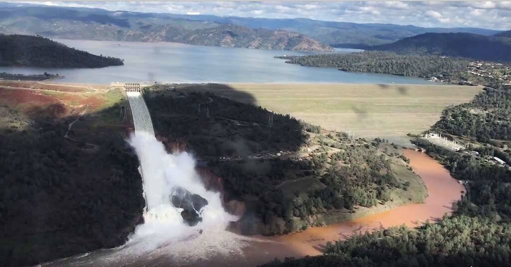 Due to a wetter than average winter, the reservoir has swelled to heights not seen in decades. As a result, the dam's primary spillway has been used heavily to accommodate the excess volume. PJ Helicopters Photo
