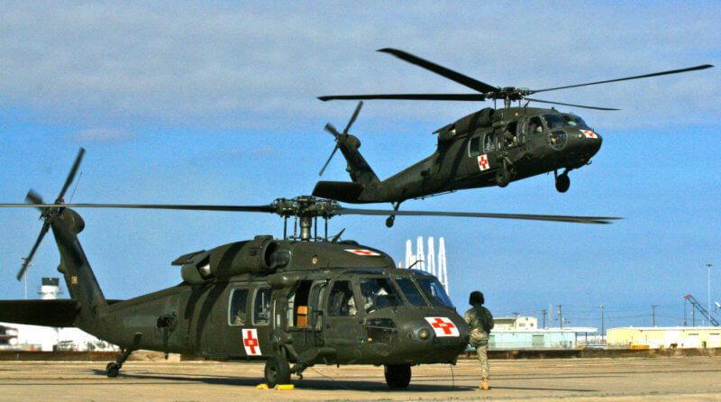 """The red crosses on these Sikorsky UH-60 Black Hawk helicopters identify them as """"Dustoff"""" or medevac aircraft. When Dustoff is called, said Ryan, """"it usually means someone is really hurt, and every second counts."""" Photo courtesy of Reuben Ryan"""