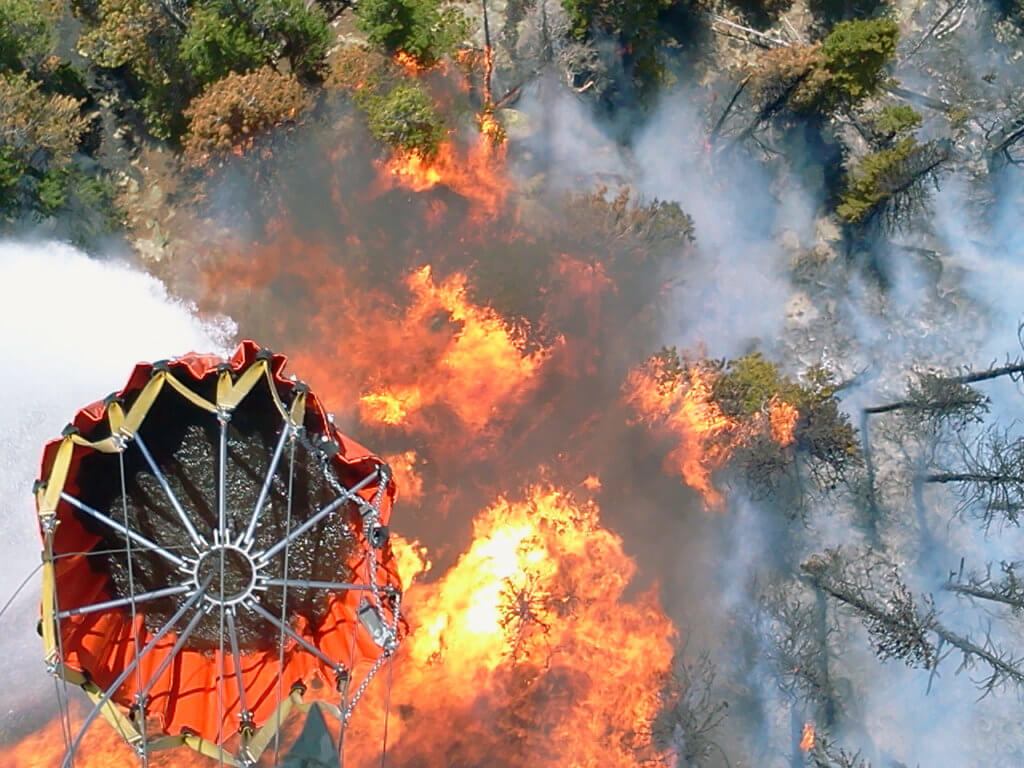 Bambi Bucket dumps water onto flames