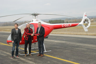 Mischa and Sancho Gelb, owners of British Columbia-based BC Helicopters, stand with Bruno Guimbal, president and CEO of Hélicoptères Guimbal. Hélicoptères Guimbal Photo