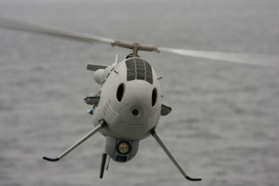 The Camcopter S-100 holds an impressive track record of supporting naval customers, with missions successfully completed on over 30 different ships on all the world's oceans, in every environment from the tropics to the Arctic. Schiebel Photo