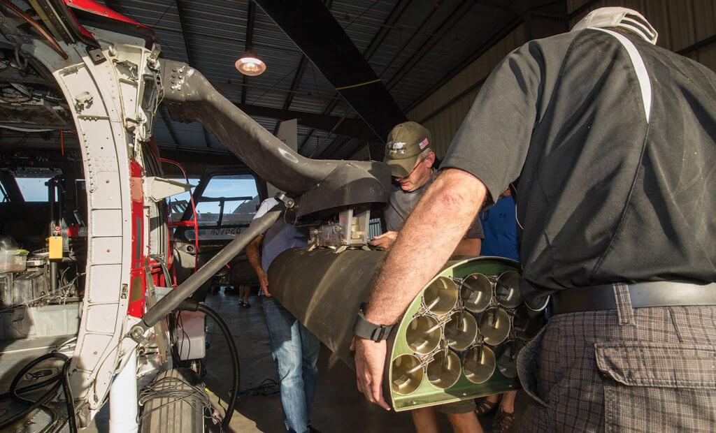Technicians install the Arnold Defense LWL-12 lightweight 2.75-inch (70mm) rocket launcher.