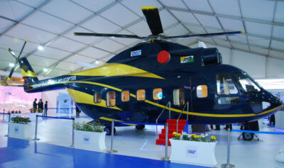 The full-scale mock-up of the Indian multirole helicopter was unveiled in the presence of Laxmikant Paresekar, T. Suvarna Raju, and other key officials at a function held at the HAL Pavilion. HAL Photo