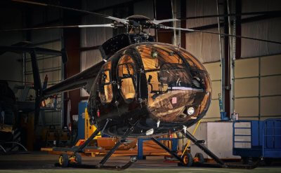 An MD 530F rests quietly in the hangar, ready for the next flight. Photo submitted by Bill Lavery