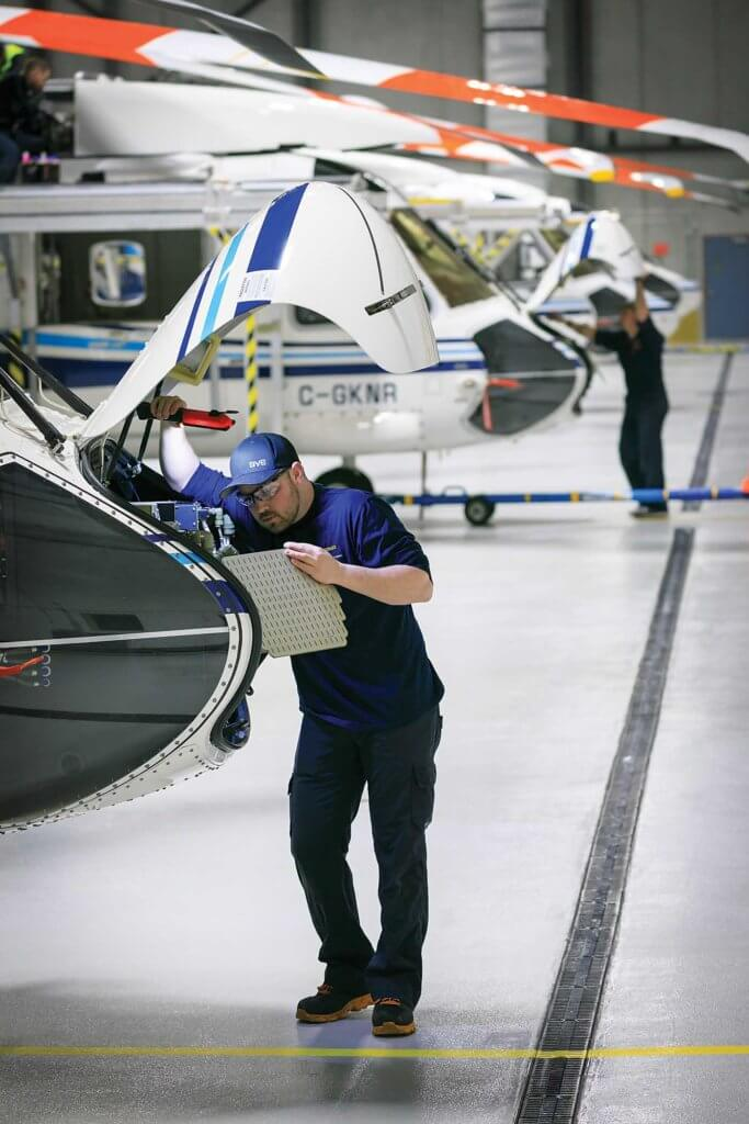 A Cougar maintenance technician performs routine system checks on a S-92 after the aircraft has completed a busy day of offshore flying. Heath Moffatt Photo