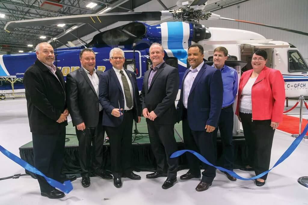 Norie cuts the ribbon to officially open the new hangar, joined by executives from Bristow, oil company customers, and provincial finance minister Cathy Bennett. Heath Moffatt Photo