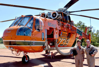 Alba Castellanos, left, and Capt Natalie Jones with an Erickson Aircrane