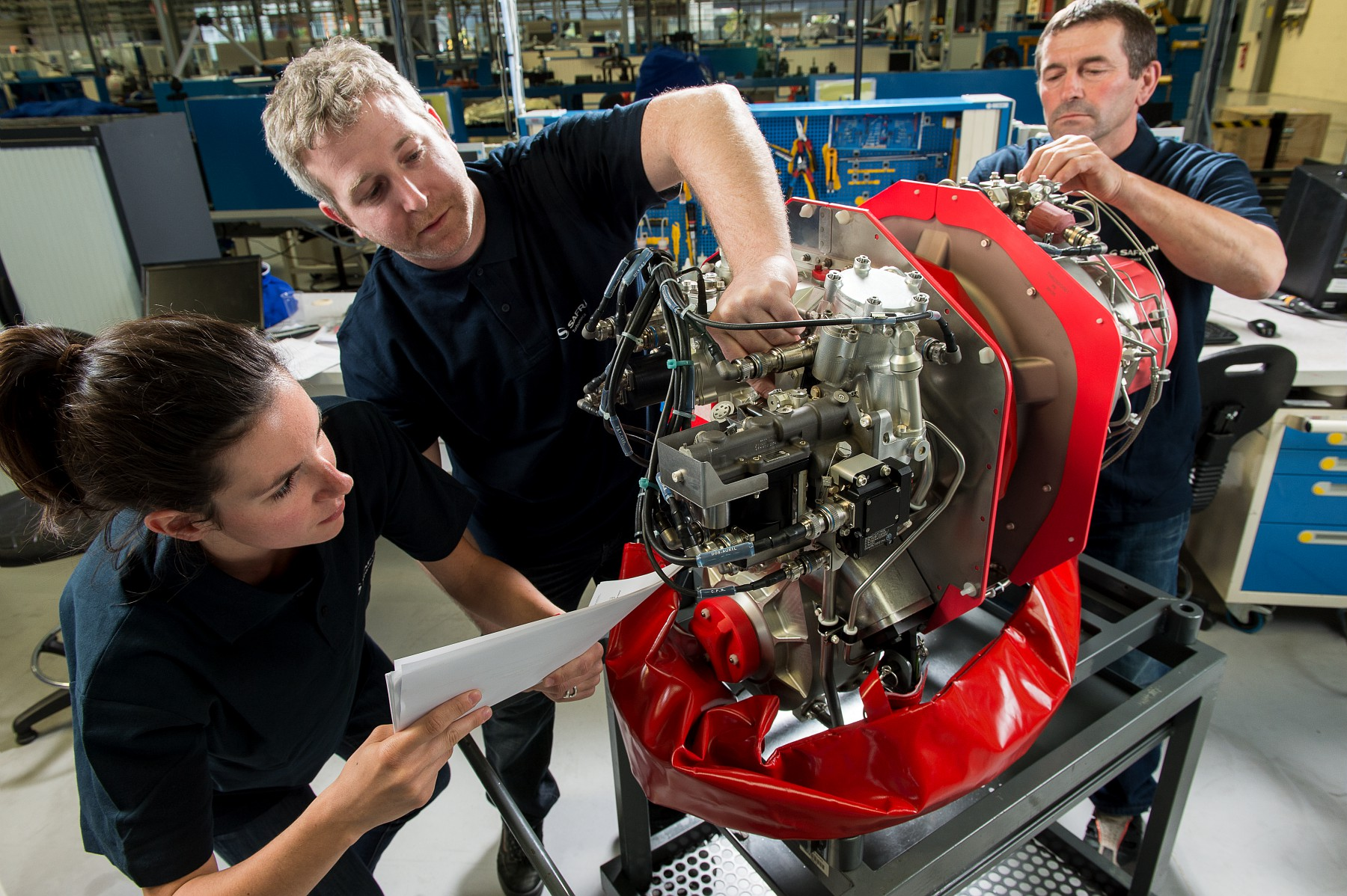 Workers surround a Safran Arrius 2R engine.
