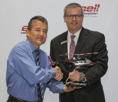 Terry Miyauchi from Arizona Department of Public Safety, left, and Bell Helicopter's Anthony Moreland, shake hands.