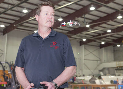 A college instructor flies a small drone inside a facility in London, Ontario. John Sing, Fanshawe College Photo