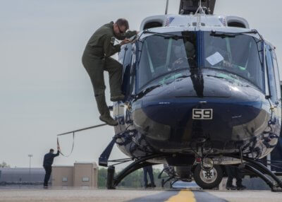 An UH-1N Iroquois pilot climbs off a helicopter after a flight at Joint Base Andrews, Maryland, April 13, 2017. The aircraft belongs to the 1st Helicopter Squadron, which conducts high-priority airlift missions and provides contingency response in the National Capitol Region. The squadron performed a medical evacuation of a downed pilot during the F-16 Fighting Falcon crash incident April 5. U.S. Air Force Photo