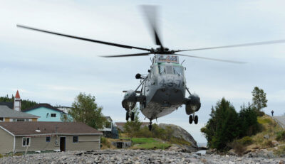 A CH-124 Sea King from 423 Maritime Helicopter Squadron, Shearwater, Nova Scotia, takes off from a river bed in the small community of Trouty, Newfoundland and Labrador. The squadron was supporting relief efforts in the province following Hurricane Igor in September 2010. MCpl Angela Abbey Photo