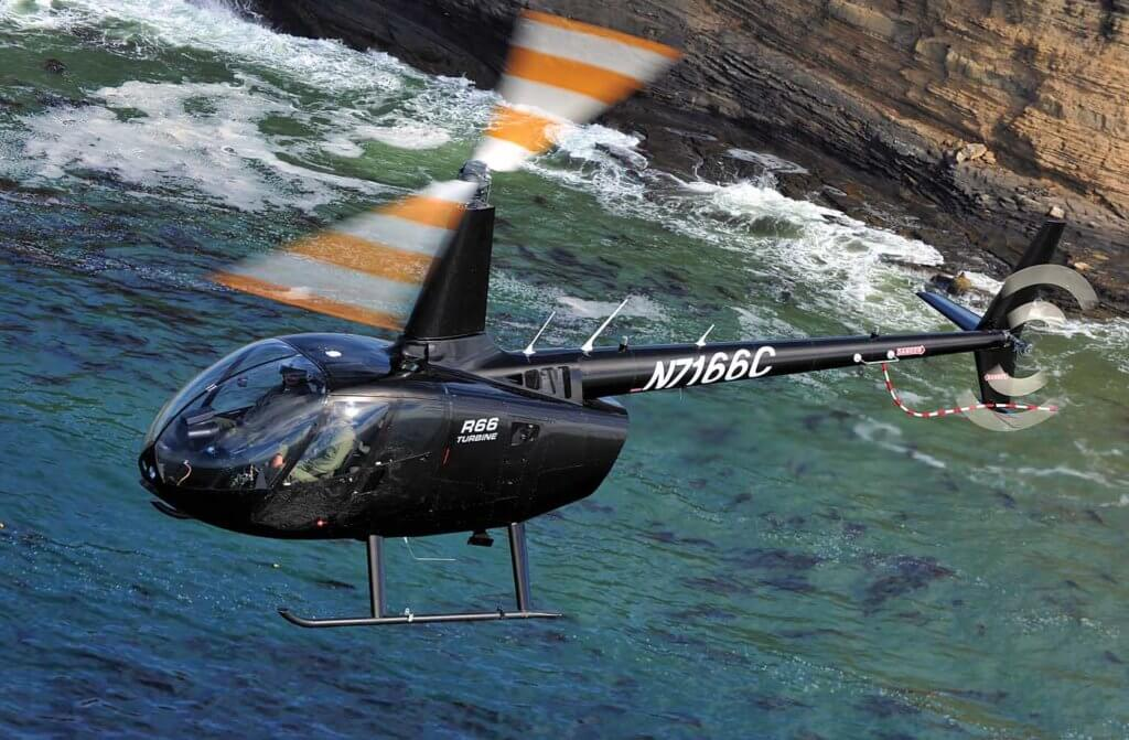 A Robinson R66 flies off the coast of California near the manufacturer's plant in Torrance. Skip Robinson Photo