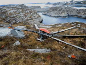 After in-flight breakup, the main rotor was found on a small island. AIBN Photo