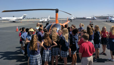 Students were given the opportunity to sit inside a helicopter to get a real vision of what it may be like to become a pilot, and to get an idea of how the airport operates and brings business to the local economy. Revolution Aviation Photo